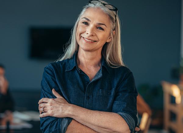 A mature woman in a blue shirt